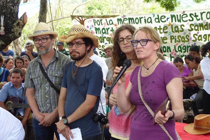 Amanda Grzyb speaking with the El Salvador team at the Sumpul Massacre commemoration in May 2019.