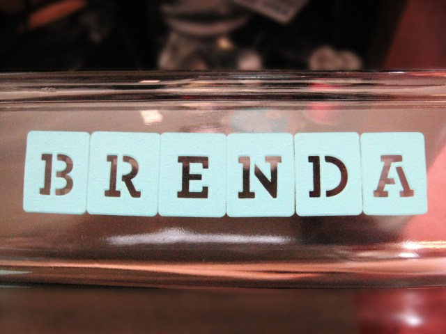 stenciled name on glass