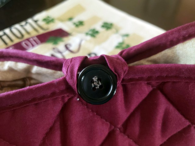 button sewn to tea towel