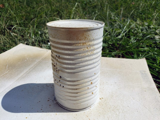 gold spray painted upcycled tin can
