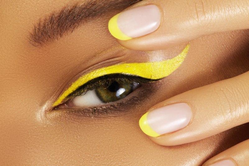 beautiful macro close female eye bright yellow eyeliner makeup   graphic eyeliner tutorial