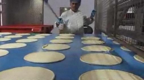 Inside a frozen pizza factory