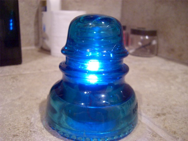 Glass insulators as LED lamps