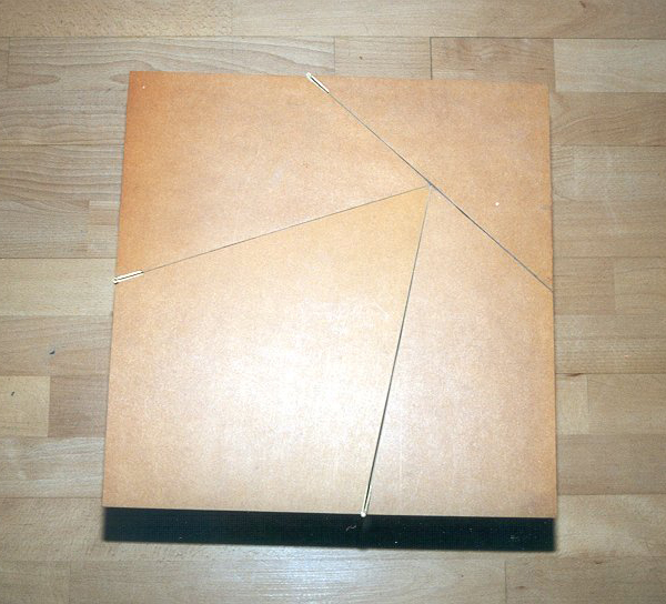 Hinged square-to-triangle dissection table