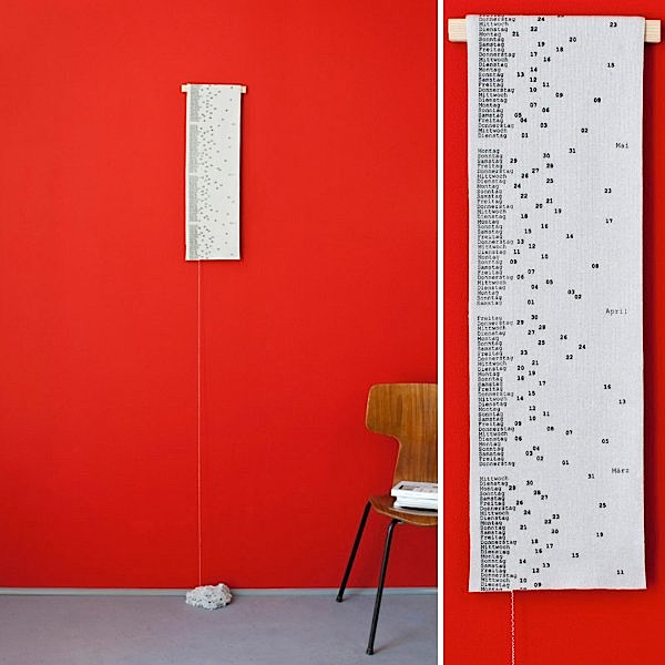 Wall calender marks time by falling apart
