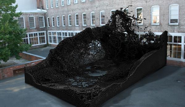 Giant fluid dynamics sculpture made of robot-glued plastic balls