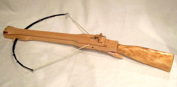 Marble-Shooting Wooden Crossbow Punches Through Plywood