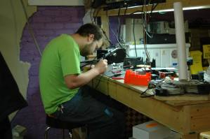At the soldering table.
