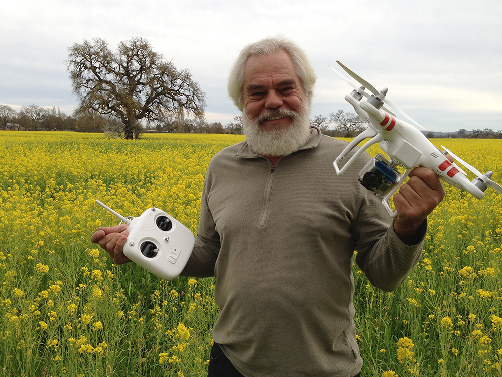 Quadcopter Flying Over a Field of Yellow Mustard