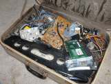 I keep several junk boxes: wood, metal, plastic, and electronics. About once a year it's a good idea to go through it all and skim off what you won't use.