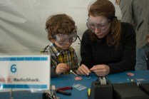 Hands-on lessons in the Radio Shack Learn to Solder tent.