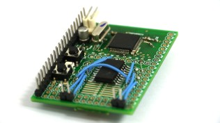 The Espruino board with an SMD H Bridge chip and connectors to drive a motor.