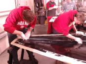 Placing multiple layers of carbon fiber around the edges to make it thicker and stronger.