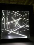 Sound activated fluorescent light sculpture.