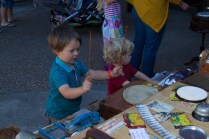 Kids playing on the homemade percussion sculptures.