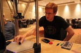 Zach from Leap Motion works with the DeltaMaker 3D printer on a vase that was sculpted using a Leap Motion and Freeform.