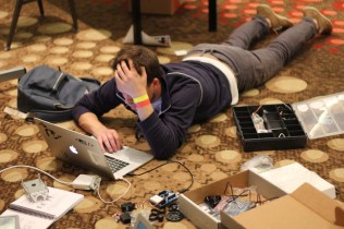 Attendees turned the conference center into a huge robotics lab. Any horizontal surface became a workspace!
