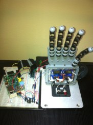 """A Raspberry PI monitors the tweets to @OurCatDoor. The PI's GPIO acts as inputs to a PICAXE 18M2 which controls servos on a robot hand. If your tweet includes any of the text below, the """"Hand of PI"""" obeys your command. Valid commands are (lowercase): one (holds up one finger); peace (peace sign); three (three fingers); hookem (Texas Longhorn fan); fist (ready to fight); open ('high five'); finger (well… this will be the most tweeted command) Project Link"""
