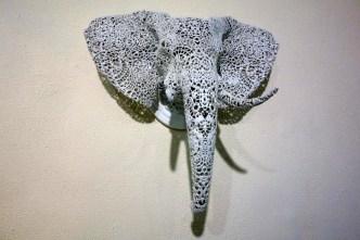 Flamboyantly decorative wall-mounted animal heads.
