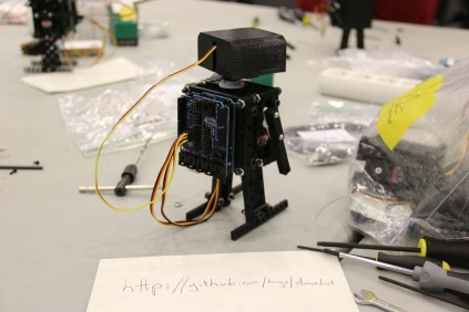 Dancebot sporting its Arduino UNO backpack.