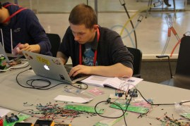 """In the """"Python and Ruby Sitting in a Tree"""" workshop, attendees programmed an Arduino to interact with sensors such as the DHT11 temperature and humidity sensor, the VCNL4000 light sensor, the HC-SR404 ultrasonic ranging module, and the HC-SR501 PIR sensor module."""