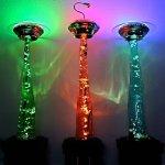 Jason Dietz' UFO Lamps stand 6 feet tall and each feature an alien abduction.