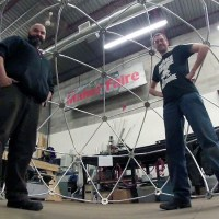 Kevin Loney (right) and Jim Akeson with completed Argus dome frame. Not pictured: Shannon Wheeler.