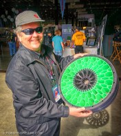 Even the four wheels which were printed as pie sections that snap fit together. Here, MAKE founder Dale Dougherty admires one of the wheel assemblies.
