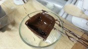 You can rotate the mold so that while the chocolate is still viscous it does not pool on the bottom and create thin walls. You want to ensure an even coating.