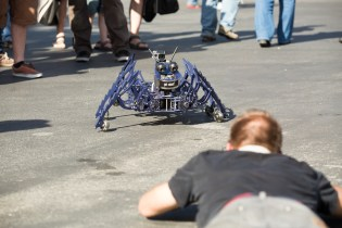 An eager photographer belly's down with Glider- just one of several robots created by Nick Donaldson of Got Robots!