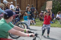 Participants crank out the juice with bike generators to power the music amplification on the Pedal Powered Stage.