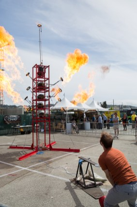 "The High Striker created by Lara Edge of Sheet Metal Alchemist is a carnival ""strongman"" game of strength — displayed on a tower of fire cannons."