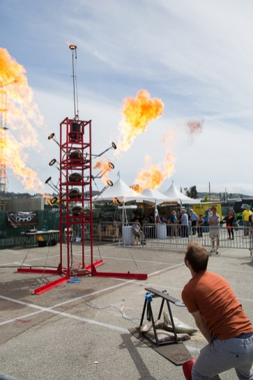 """The High Striker created by Lara Edge of Sheet Metal Alchemist is a carnival """"strongman"""" game of strength — displayed on a tower of fire cannons."""