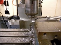 Mitering the top tube. I used FeatureCAM to write NC programs for the tube miters based on imported Inventor parts files. The clamps holding the thin-wall tubes were also cut from FeatureCAM programs based on the tube profiles from the CMM.