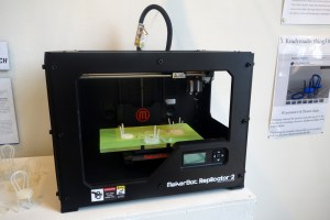Believe it or not 3D-printers are still a new phenomenon to many. And here a MakerBot Replicator 2 sits adjacent to printouts containing information about the No. 14 Thonet chair, the best-selling chair in the history of humankind, and now yours for the low-low cost of a download.