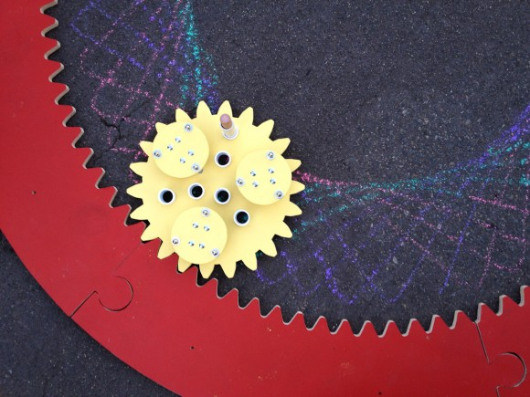 Giant Spirograph Makes Mathematically Perfect Chalk Drawings On The Street