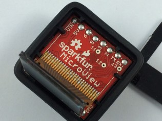 Close up of the inside of the MicroView showing the three vias we need to add the bootlader
