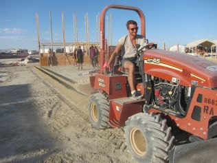 Trench digger for burying electrical cable