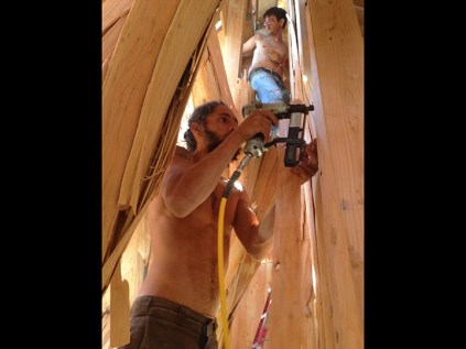 Nailing up the bark on the inside chambers of Embrace