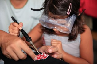 Makers of all ages learned an essential skill in the RadioShack Learn to Solder tent.