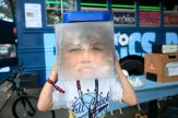 Sam Herman, 10, models a Fresnel Lens Recycle Bin, one of the many interactive exhibits made in his father's Physics Bus.