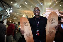 Thulani Ngazimbi from The Rad Black Kids makes custom longboards and guitars. The group also plants a tree for every product sold.