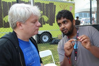 Amogha talking about the new board with Tom Igoe, one of the co-creators of the Arduino