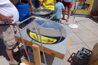 This solar cooker was on the deck cooking onions.