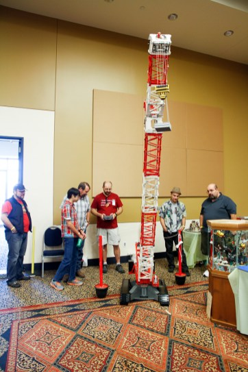 """""""12FeetTall--AllLego!"""": TJ Avery from the Texas LEGO Users Group showed this 12-foot-tall crane, with a structure made 100% from LEGO bricks! Even better it's fully remote controlled and could move across the floor, raise and lower its boom and lift loads. TJ had been working on this model for almost a year and this was the first time it had been shown in full operational condition. """"PercyPeacockArtCar"""": Art Cars were invented in Houston, so no Maker Faire here would be complete without them. Percy Peacock, built by a team of middle-school students and maintained by Mark and Sherri Garrett, helped represent the Art Car community at the Houston Mini Maker Faire."""
