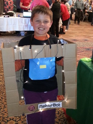 """""""MakerBot Fan"""": our event was held the day after Halloween, so many attendees came in costumes. This young man is obviously MakerBot's biggest fan! How cool is that?"""