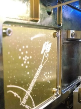 Artist Jon Lomberg, who co-created the Voyager Golden Record, designed this Golden Plate which is installed inside the 3D printer.