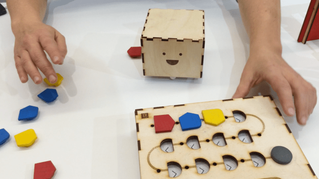 Teaching kids to program with wooden blocks