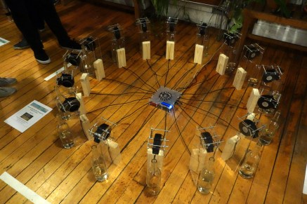 An installation of bottles filled to different levels with water, while air is blown across the bottles' lips. The tune is both subtle and pleasant. The bottles account for the cardinal, ordinal, and further directional divisions.