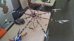 Interesting Octocopter by Driven Software. Weighting 1.2 kilos (~2.6 lbs), it can lift 2 kilos (~4.4 lbs) easily.